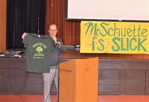 Photo of principal holding T-shirt