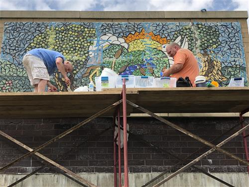 Photo of teachers working on mural