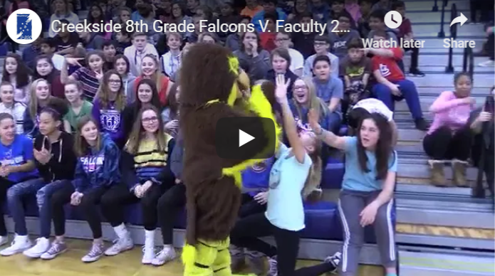 Photo of Falcons mascot high-fiving students