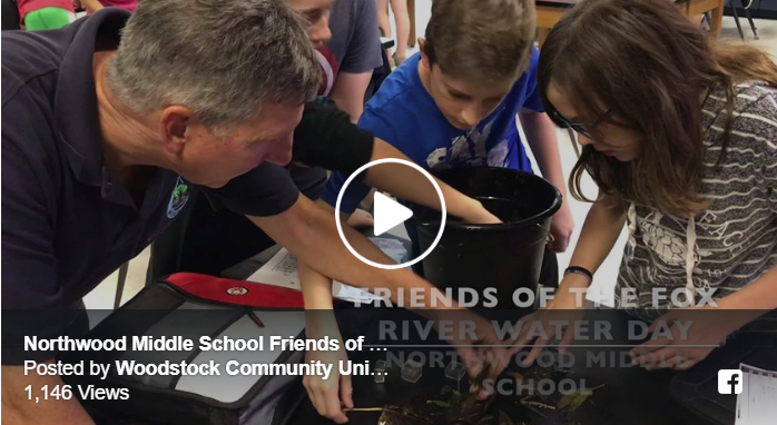 Photo of teacher helping students with creek samples