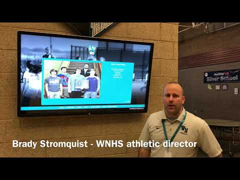 AD Brady Stromquist with WNHS touchwall