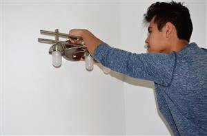 Photo of student installing light fixture