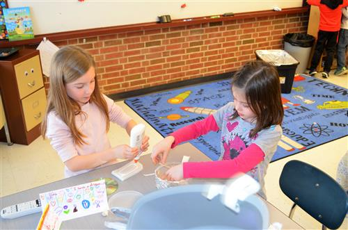 Photo of two students working on igloo project