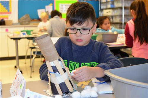 Photo of student working on igloo project