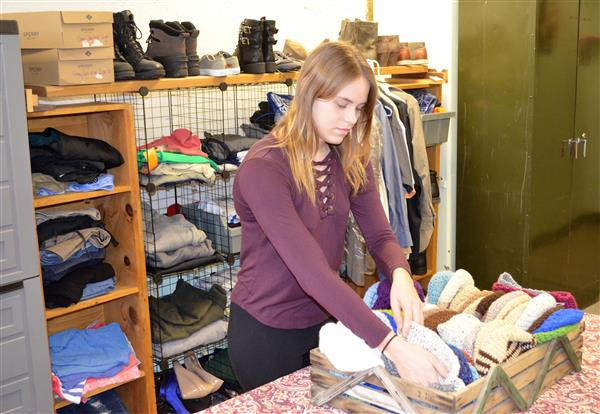 Photo of WHS student working in the school's Kindness Closet