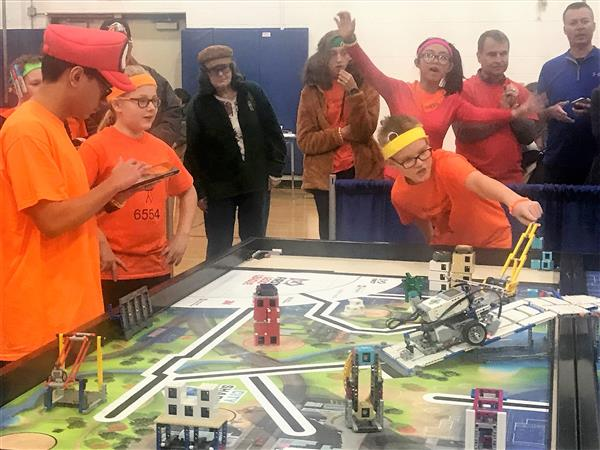 Photo of students in robotics competition