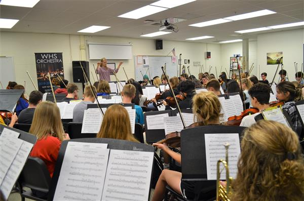 Photo of teacher conducting orchestra