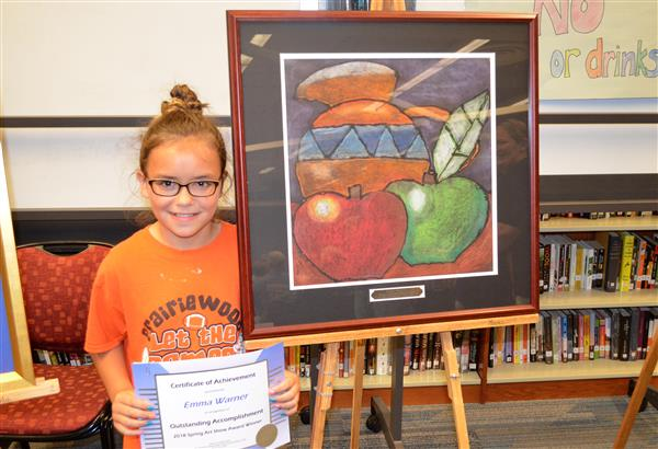 Photo of student posing with painting