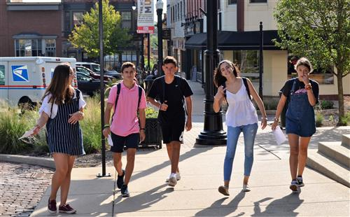 Photo of students walking in town