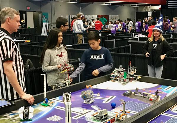Photo of students competing at state Lego robotics competition