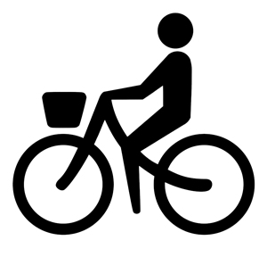 Silhouette image of a person riding a bicycle