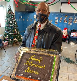 Photo of retiring employee Bennie, with a cake